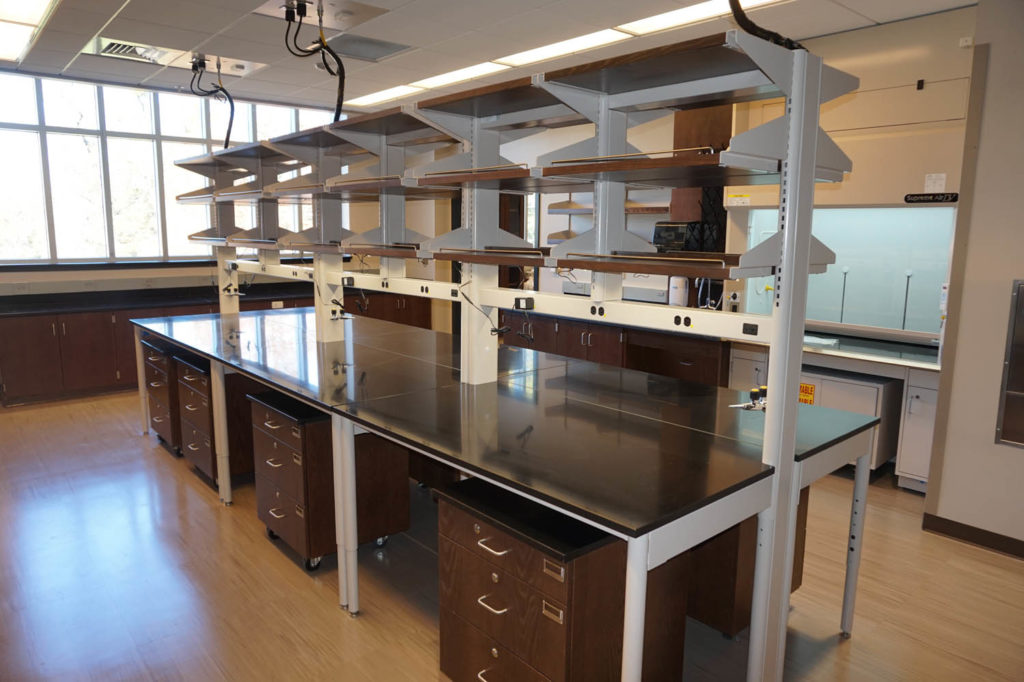 Adjustable System with epoxy tops and mobile cabinets (2)